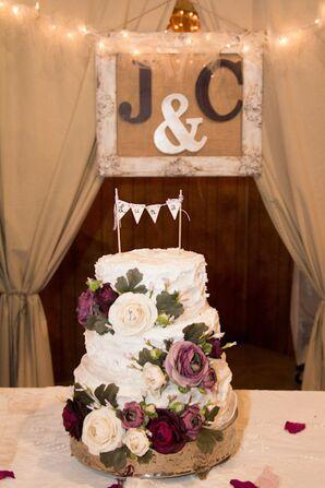 Ruffled White Wedding Cake with Purple and White Ranunculus Flowers