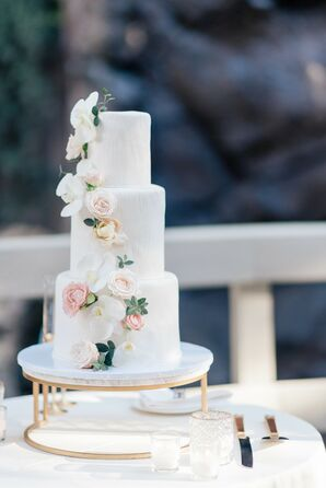 Three-Tier Simple Wedding Cake With White Flowers on White-and-Gold Stand