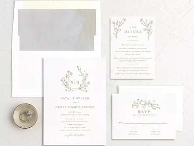 Monogram bordered by wreath and event details in brown on white background