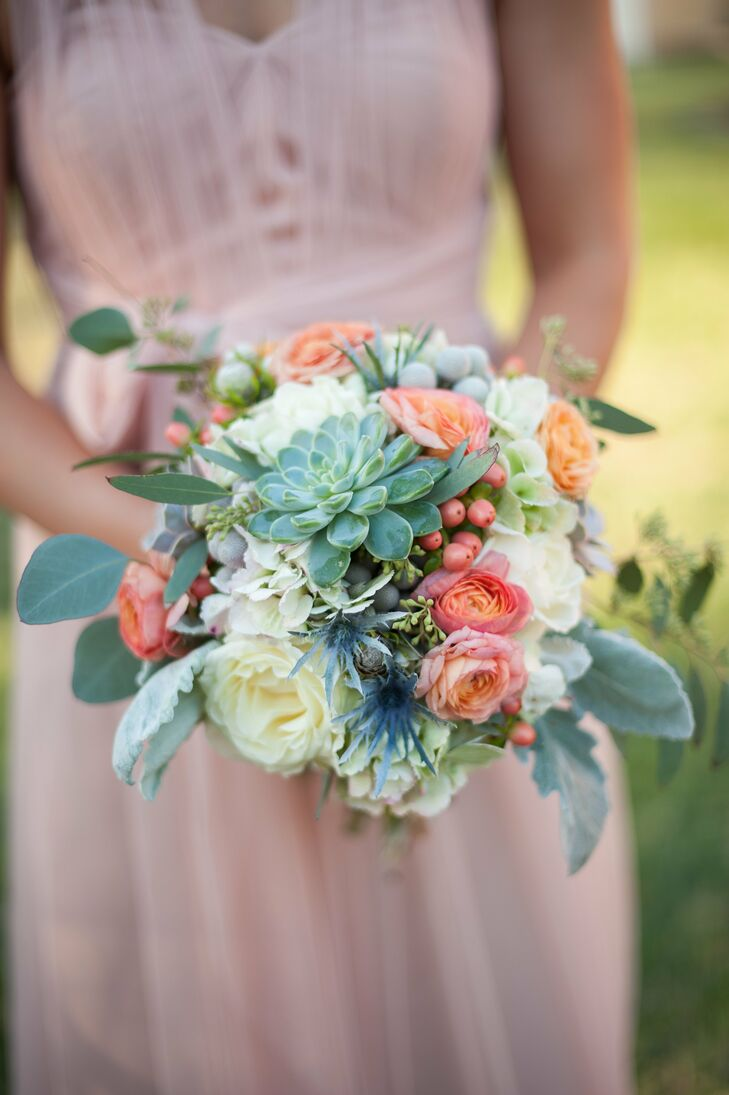 """The bridesmaids carried peach hypericum berries, green succulents, blue thistle, mint dusty miller, peach ranunculus, ivory roses and seeded eucalyptus. """"They were gorgeous and coordinated so well with their accessories,"""" Jackie says."""