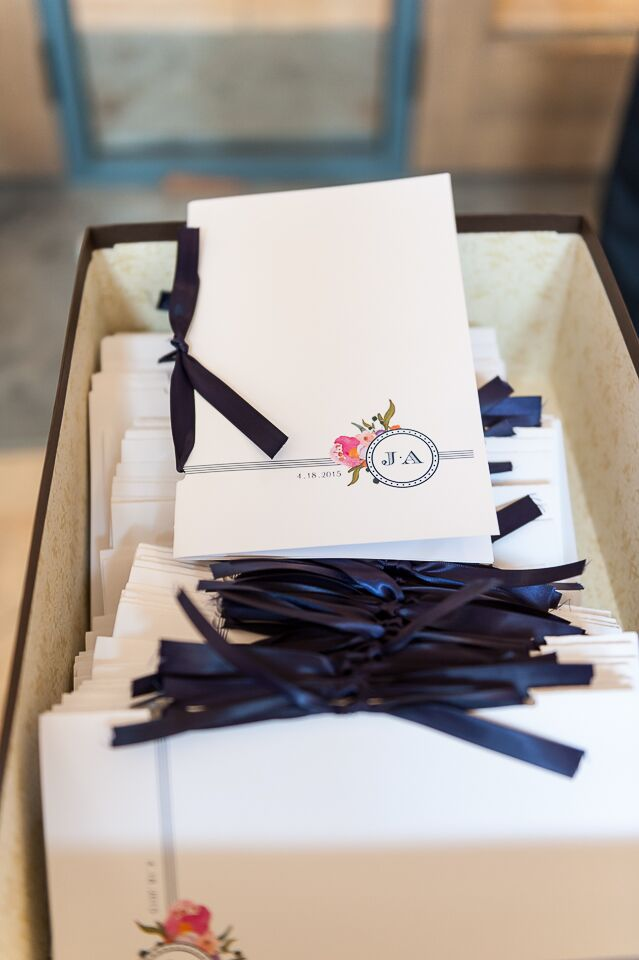 Julia knew exactly what she wanted for the invitations: letterpress and a custom monogram. They used the monogram as a motif throughout the stationery. Each program even had the symbol on its border with a coral flower accent.