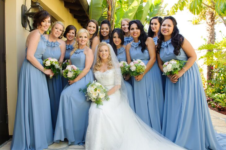 """""""Jill wanted her best friends to feel beautiful and romantic,"""" the couple says. """"With sparkly shoes and crystal earrings, they each looked like a vision of Cinderella. Jill's matrons of honor, her sister-in-law and best friend, wore sparkly belts to set them apart."""""""