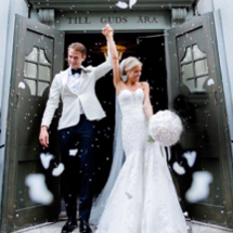bride in Morilee dress and groom holding hands exiting ceremony
