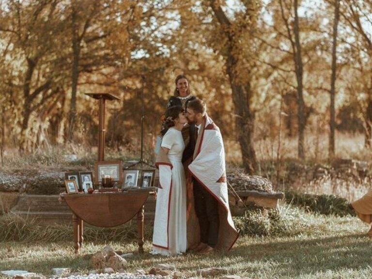 couple kissing during blanket ceremony at Native American wedding ceremony