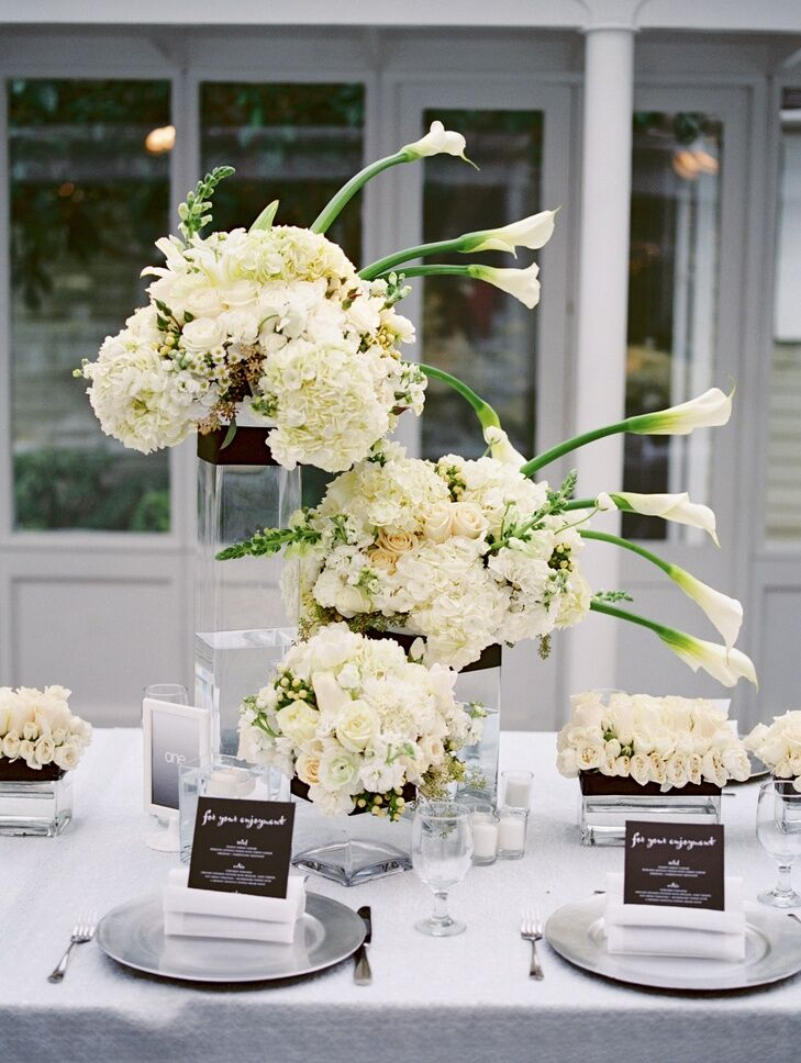 A modern centerpiece idea with white florals