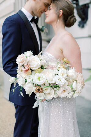 Bride Carries Large Cascading Bouquet of Roses