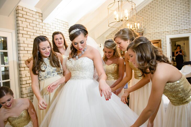 The bridesmaids wore floor length dresses with gold sequins and champagne chiffon.
