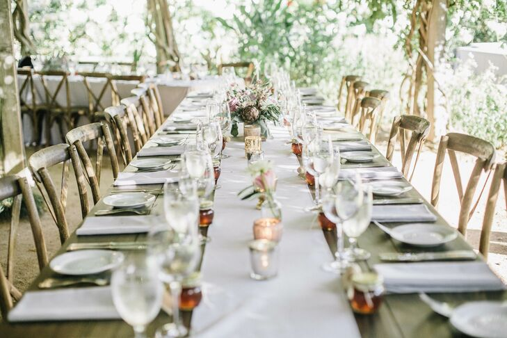 Tables were set without linens, while guests took a seat in cross-back, wooden chairs.