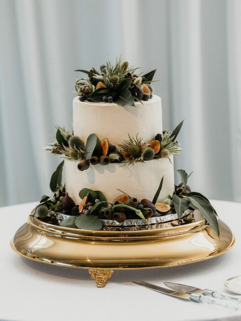 Two-tier white rustic wedding cake with succulent decorations