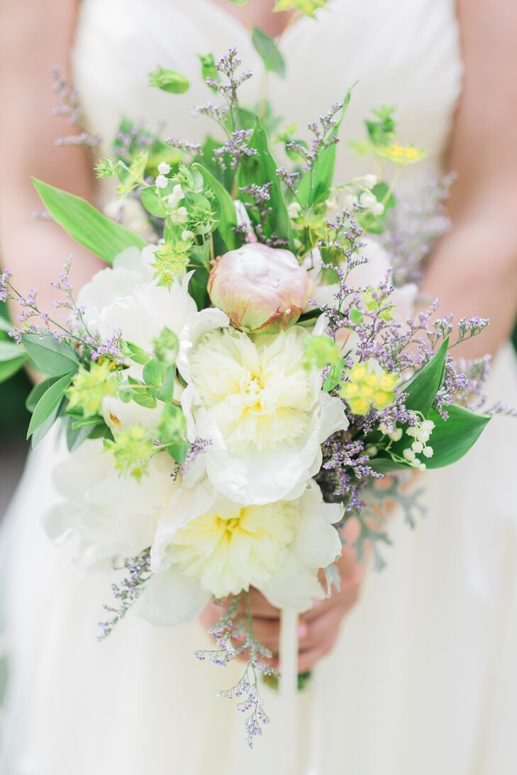 Emily carried a loose bouquet of ivory and blush peonies, wildflowers and greenery.