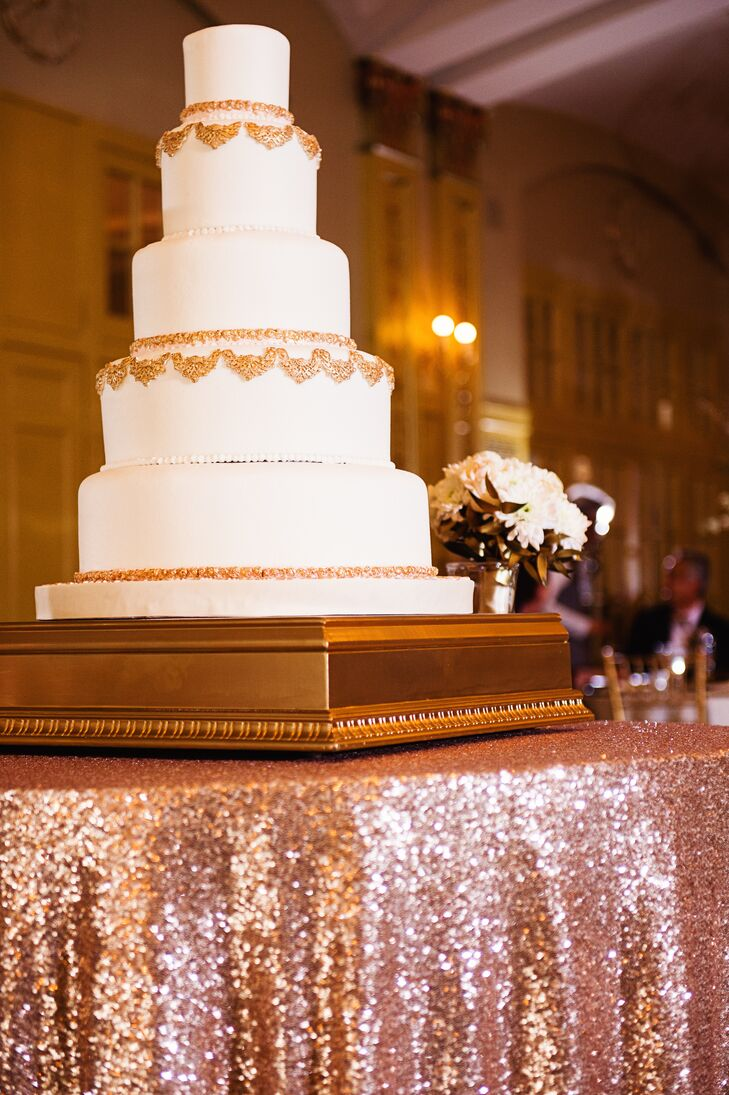 Christine and Keith enjoyed a five-tier white fondant wedding cake decorated with ornate gold detailing. The cake was white cake with hazelnut praline mousse and chocolate cake with caramel mousse. Yum!
