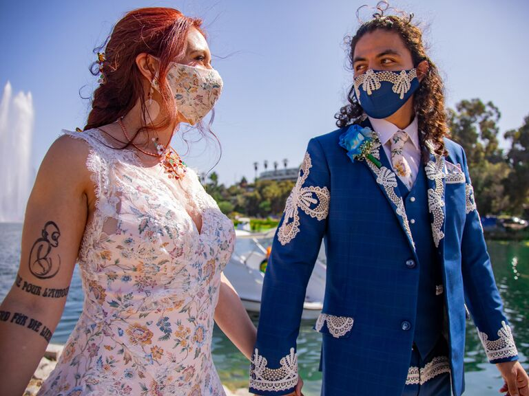 Bride and groom wearing custom wedding masks