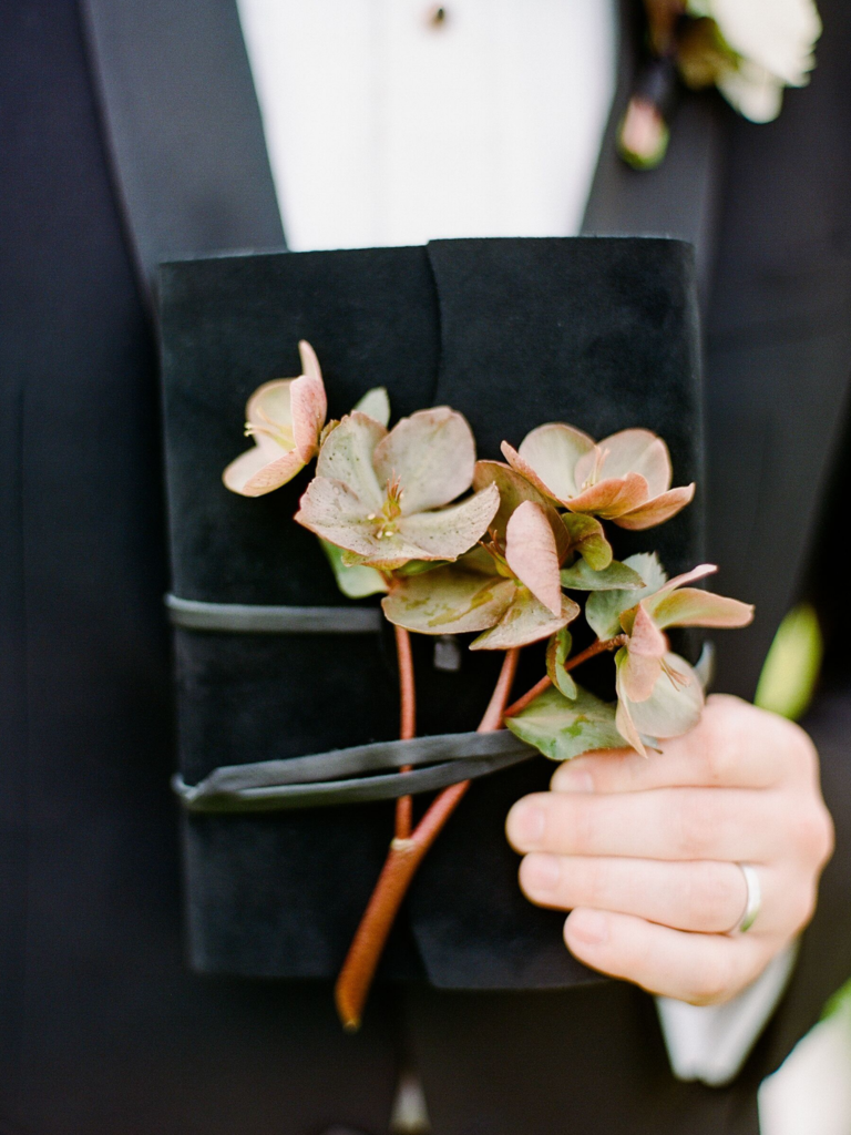 Hellebore blooms on vow book