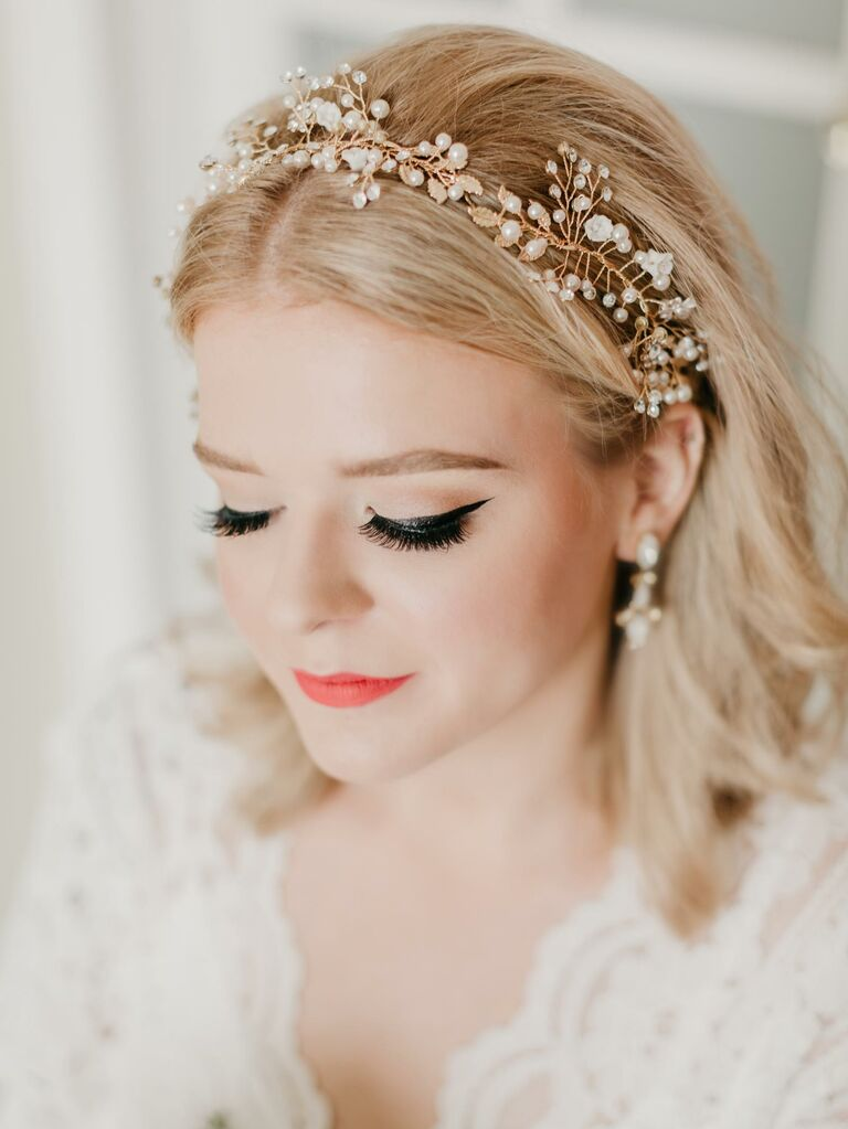 Center part with loose curls and a sparkly headband