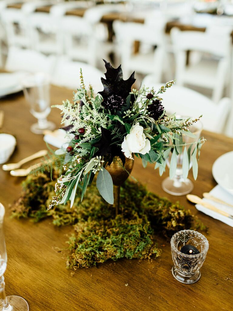 Wedding Centerpieces Moss and dark leaves