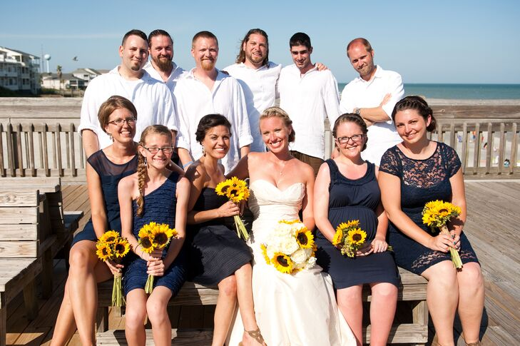 The bridesmaids wore mixed short navy dresses with beige crocheted foot bracelets.