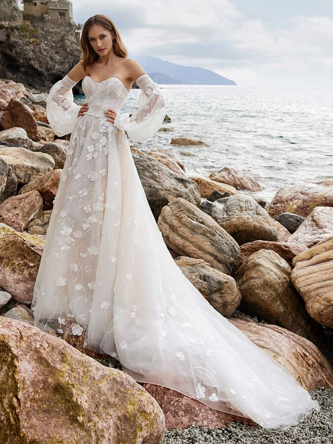 Ines by Ines Di Santo strapless trumpet wedding dress with detachable sleeves.
