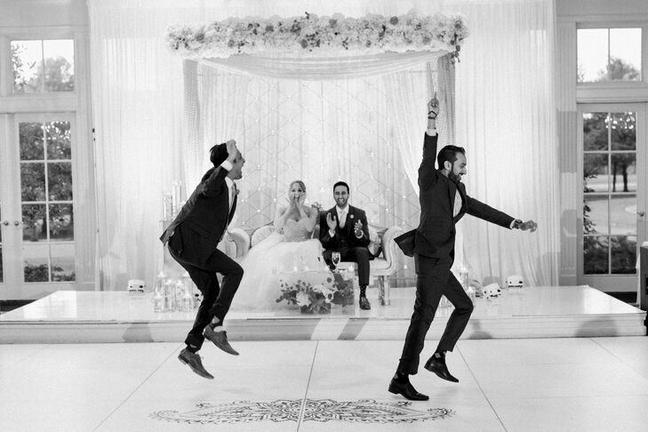At the Hindu reception, the newlyweds sat on a slightly elevated white couch that overlooked the dance floor—prime seating as the night went on.