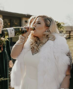 Glamorous Bride Sips on Champagne
