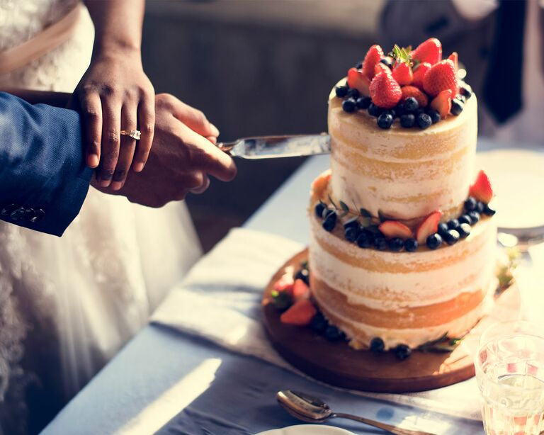 couple cake cutting COVID