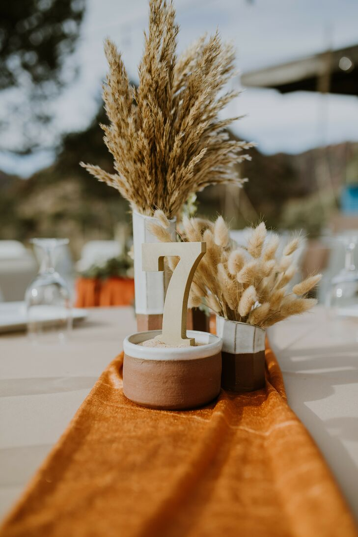 Rustic Centerpieces and Table Numbers at Texas Wedding