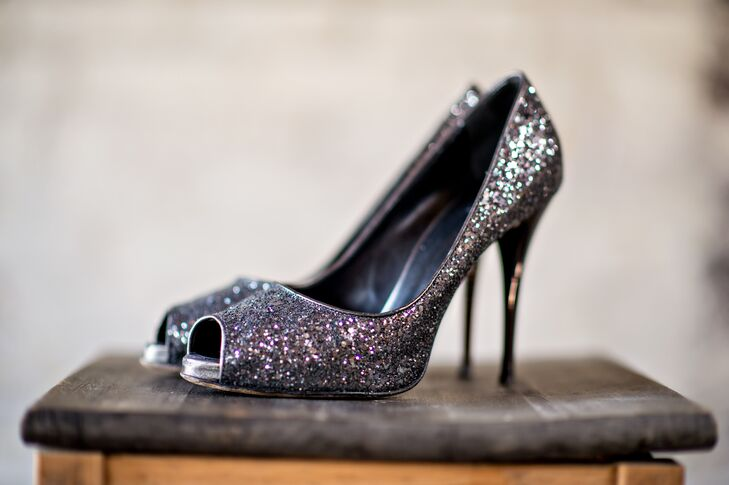 The bride wore shimmery silver shoes with an open-toed front on her wedding day.