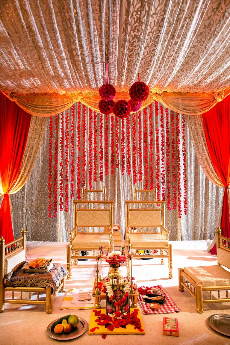 Gold-and-red mandap with lots of decorations