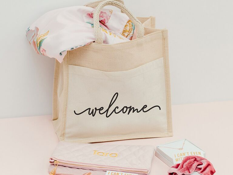 Jute bag that reads Welcome with gifts