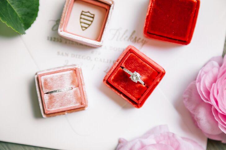 Evgeniya's engagement and wedding rings were classics, featuring round diamonds.