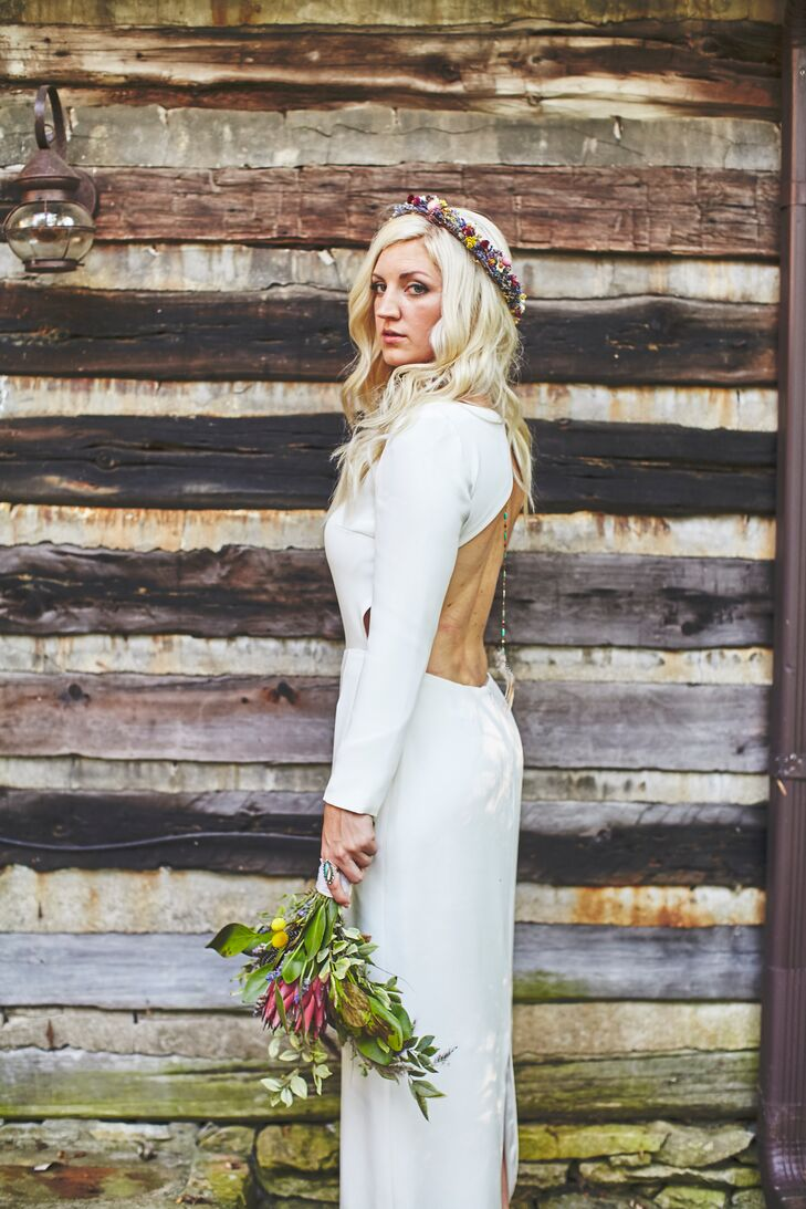 """Angela wore Cheyne by Houghton, an ivory silk crepe long-sleeve modern gown with an open back. """"It was sexy, timeless, unique and beautifully simple,"""" Angela says. """"I felt more stunning than ever in that dress. It reminded me instantly of Cameron and how he has changed my life with his minimalist demeanor."""""""