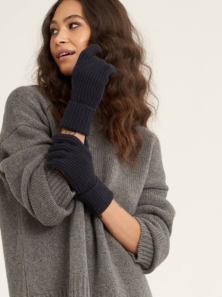 Women wearing cozy black cashmere gloves