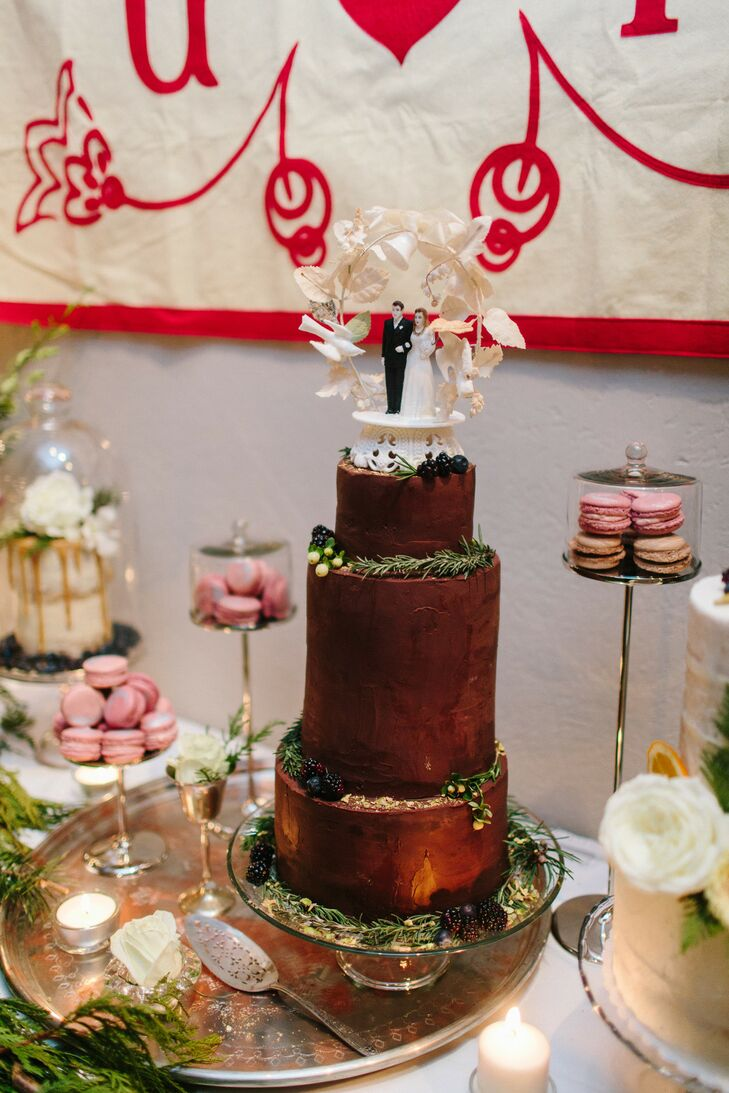 Chocolate Wedding Cake With Other Desserts at Cozy Winter Wedding
