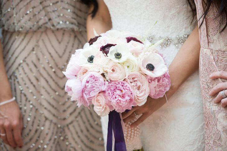 Lidia's favorite flowers are peonies, so she had to have them in her bouquet. Florist Pristine Design added white anemones, pink garden roses, white ranunculus and burgundy ranunculus for a lush arrangement. The stems were wrapped with oversized white pearls -- a detail Lidia loved.