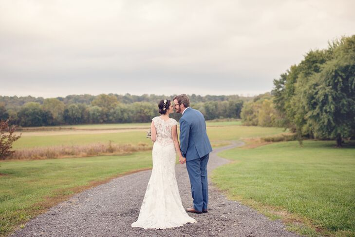 """""""I really wanted a backless dress or one with a really unique design on the back,"""" says Erin. """"The manager at Betsy Robinson's Bridal Collection near Baltimore, Maryland, nailed it by pulling the perfect dress."""" She chose a romantic ivory mermaid-style wedding dress covered in sweet lace detailing and accented with an illusion back."""