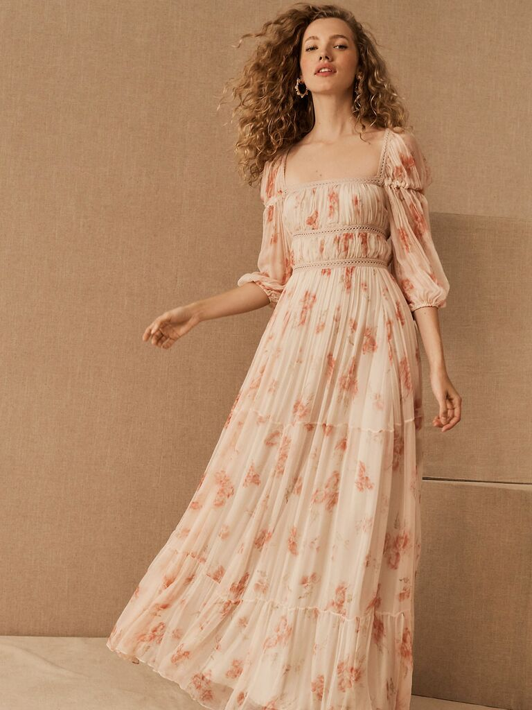 Light pink floral print fall wedding guest dress with sheer 3/4 length sleeves