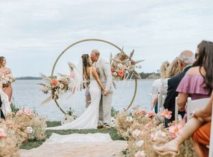 For their Cape Cod wedding, Stephanie and Shaun leaned into a boho aesthetic with a beige-and-peach color palette. To bring their vision to life the c