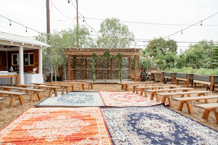 Rug-Laden Ceremony Aisle at Riverbed Farms in Anaheim, California