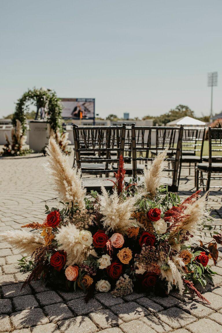 Pampas grass ceremony aisle arrangement