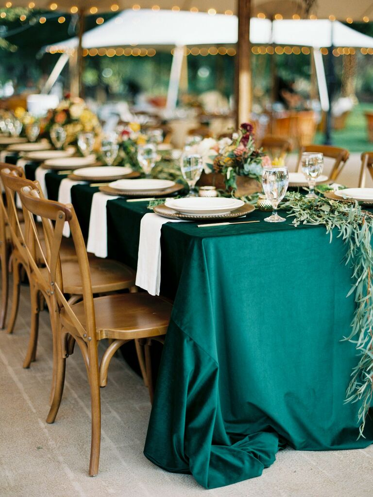 Emerald green table cloth at outdoor tented wedding reception