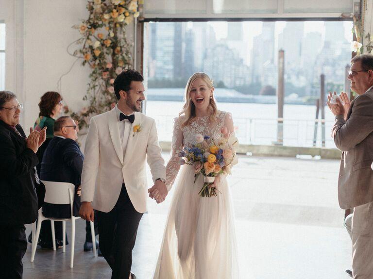 Couple celebrating down aisle