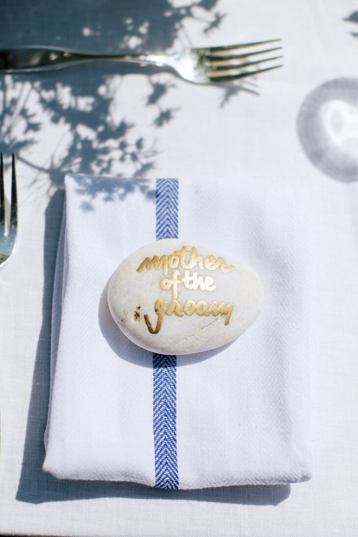Lindsay and Jay both collected rocks from the beach when they were young, so they wrote on the stones and used them as place cards.