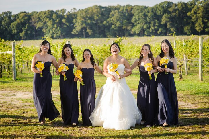 The bridesmaids wore floor length navy gowns while Jennifer whore a Vera Wang classic ballgown.