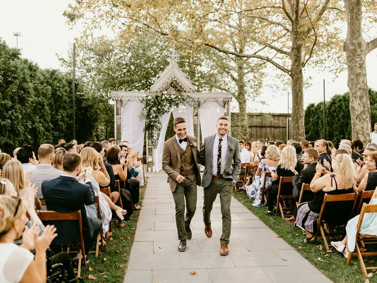 Grooms leaving ceremony at natural-styled wedding