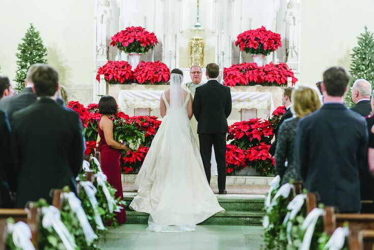 Church ceremony decorated with red poinsettias