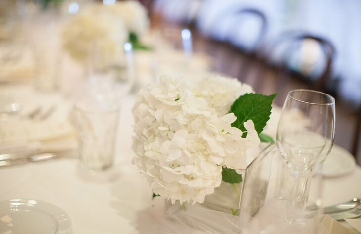 The simplicity and minimalism of the wedding flowers carried over into the reception. A few bunches of white hydrangeas decorated the dinner tables.