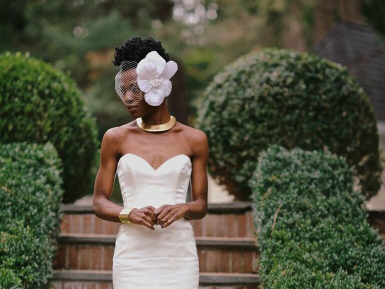 Bride in strapless Rivini dress with décolletage showing