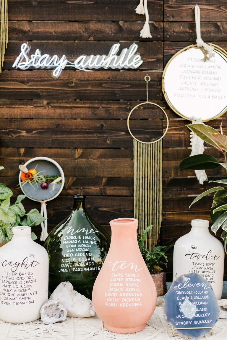 Calligraphed clay pots as seating chart