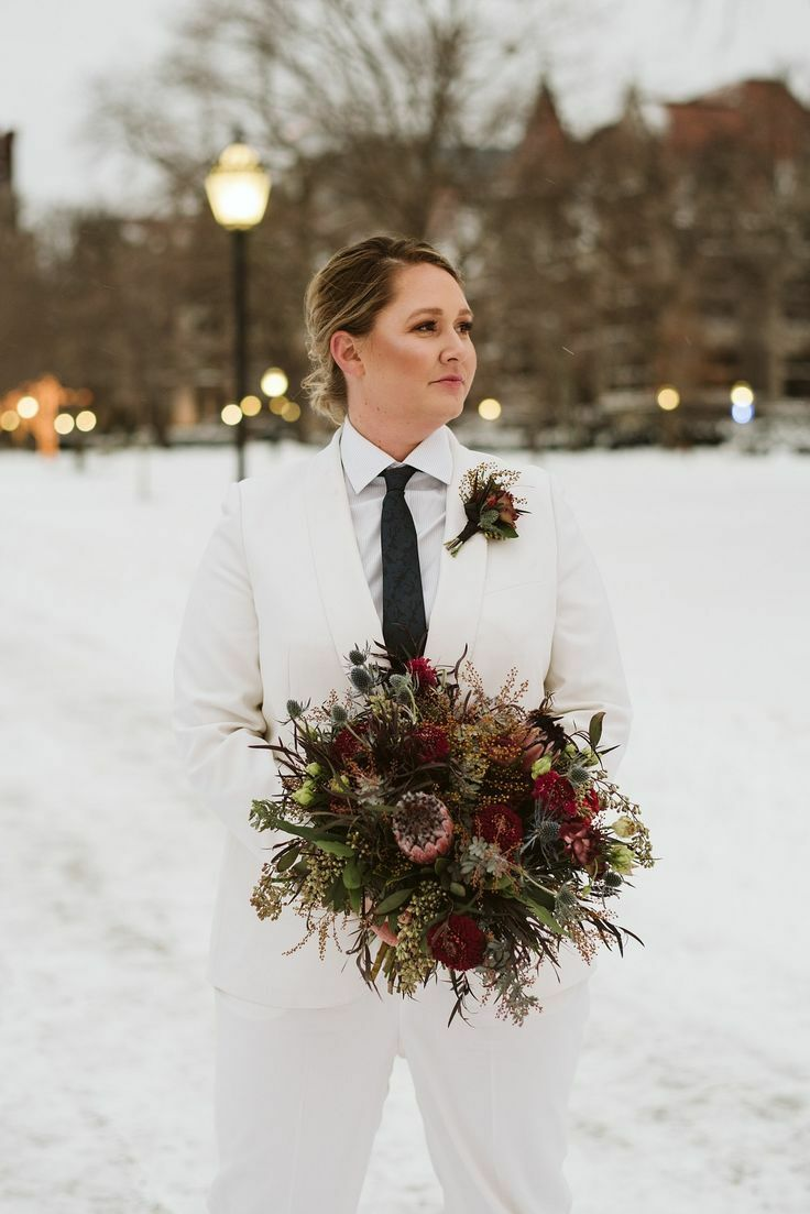 To-be-wed holding protea bouquet