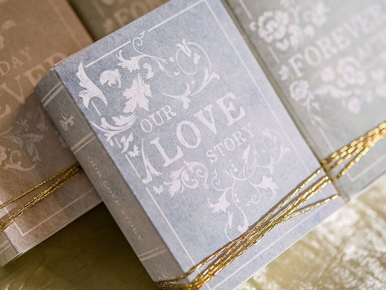 'Our Love Story' in vintage white type on faded gray book box cover