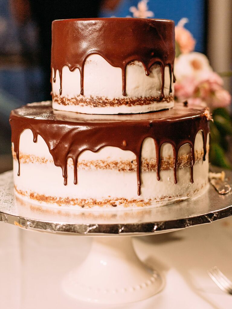 Two-tier semi-naked rustic wedding cake with chocolate ganache drizzle